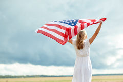 Happy woman with american flag on cereal field Royalty Free Stock Photos