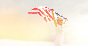 Happy woman with american flag outdoors Royalty Free Stock Photography