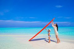 Free Happy Woman And Little Girl At White Beach With Stock Photos - 55201223