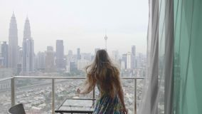 Happy Woman in Apartment. Young happy woman running in apartment to the terrace raising her hands and embracing the world. Freedom,vacation and happiness concept stock video footage
