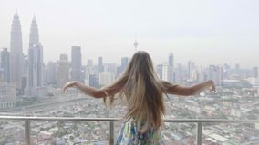Happy Woman in Apartment. Young happy woman running in apartment to the terrace raising her hands and embracing the world. Freedom,vacation and happiness concept stock footage