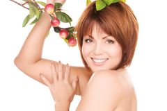 Happy woman with apple twig Royalty Free Stock Photo