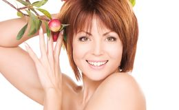 Happy woman with apple twig Royalty Free Stock Image