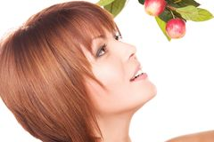Happy woman with apple twig Royalty Free Stock Photos