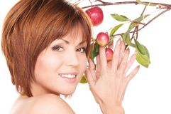 Happy woman with apple twig Royalty Free Stock Images