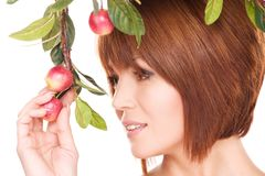 Happy woman with apple twig Stock Photography