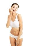 Happy woman applying shaving foam on her face.  royalty free stock photos