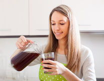 Happy woman in apron with fresh quass Royalty Free Stock Image