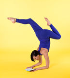 Happy woman arm balance yoga  blue on yellow Royalty Free Stock Images