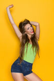 Happy Woman With Arm Raised Stock Photography