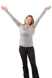 Happy woman with arms in the air Royalty Free Stock Images
