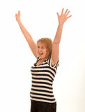 Happy woman with arms in the air. Excited happy casual woman celebrating with arms and hands up in the air Stock Photo