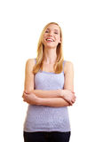 Happy woman with arms crossed Royalty Free Stock Photos