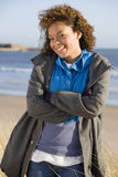 Happy woman with arms crossed on beach Royalty Free Stock Photography
