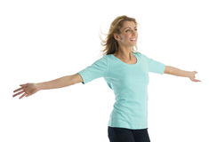 Happy Woman With Arms Outstretched Looking Away Stock Image