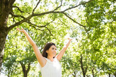 Happy woman with arms raised Stock Photo