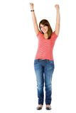 Happy woman with arms up Royalty Free Stock Photography