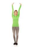 Happy woman with arms up. Stock Photo