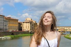 Happy woman in Arno river and buildings background in Florence, Italy. royalty free stock images