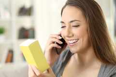 Woman asking information about a product Royalty Free Stock Image