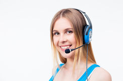 Happy woman assistant operator in headset Royalty Free Stock Photo