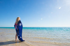 Happy woman Australian flag at ocean Royalty Free Stock Image