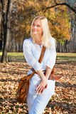 Happy woman at the autumn colored park. Happy young woman at the autumn colored park royalty free stock photo