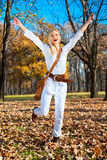 Happy woman in the autumn colored park . Happy young woman in the autumn colored park royalty free stock photos