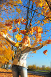 Happy woman  with autumn leav Royalty Free Stock Photo