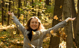 Happy woman in autumn park Royalty Free Stock Images
