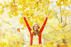 Happy woman in autumn park Stock Photos