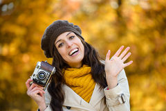 Happy woman in autumn waving Royalty Free Stock Photography