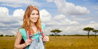 Happy woman with backpack over african savannah Stock Image