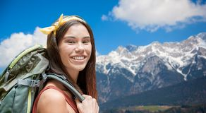 Happy woman with backpack over alps mountains royalty free stock photos