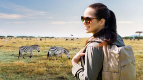 Happy woman with backpack traveling in africa Royalty Free Stock Images