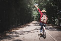Free Happy Woman Backpacker With White Bicycle In Nature Stock Photography - 110809922