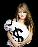 Happy woman with a bag of American dollar bills Stock Images