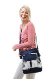 Happy woman with a bag Royalty Free Stock Images