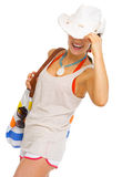 Happy woman with bag hiding behind hat Royalty Free Stock Photography