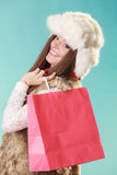 Happy woman with bag shopping. Winter fashion. Royalty Free Stock Image
