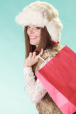 Happy woman with bag shopping. Winter fashion. Royalty Free Stock Photo