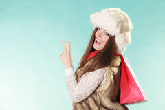 Happy woman with bag shopping. Winter fashion. Stock Image