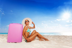 Happy woman with baggage on vacation Stock Image