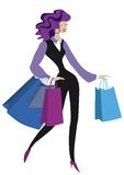 Happy woman with bags stock photography