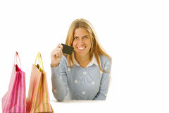 Happy woman with bags and credit card Royalty Free Stock Photography
