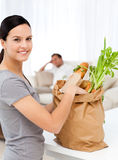 Happy woman with bags in the kitchen Royalty Free Stock Photo