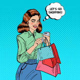 Happy Woman with Bags Using Smart Phone at Shopping. Pop Art. Vector illustration royalty free illustration