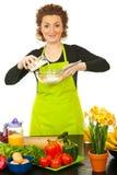Happy woman baking Stock Image