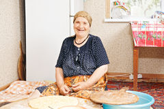 Happy woman baking bread Royalty Free Stock Photos