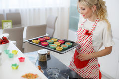 Happy woman baking in her kitchen. Stock Photography